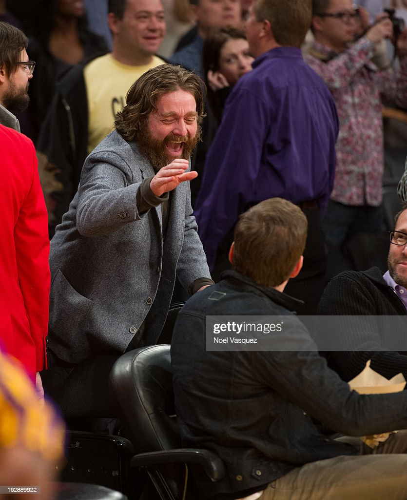 <a gi-track='captionPersonalityLinkClicked' href=/galleries/search?phrase=Zach+Galifianakis&family=editorial&specificpeople=2154769 ng-click='$event.stopPropagation()'>Zach Galifianakis</a> (L) and <a gi-track='captionPersonalityLinkClicked' href=/galleries/search?phrase=Will+Arnett&family=editorial&specificpeople=209259 ng-click='$event.stopPropagation()'>Will Arnett</a> attend a basketball game between the Minnesota Timberwolves and Los Angeles Lakers at Staples Center on February 28, 2013 in Los Angeles, California.