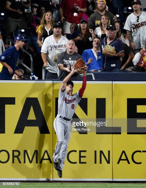 Zach Granite of the Minnesota Twins makes a catch at the wall on a ball hit by Jose Pirela of the San Diego Padres during the fourth inning of a...