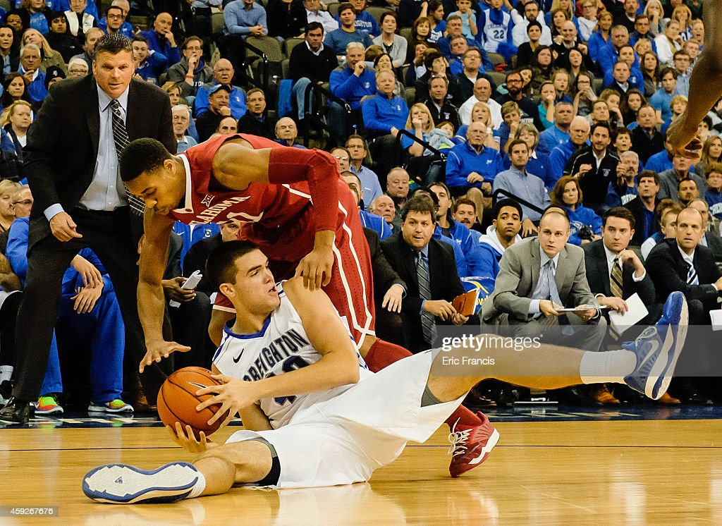 Zach Hanson of the Creighton Bluejays and Isaiah Cousins of the Oklahoma Sooners fight for a loose ball during their game at CenturyLink Center...