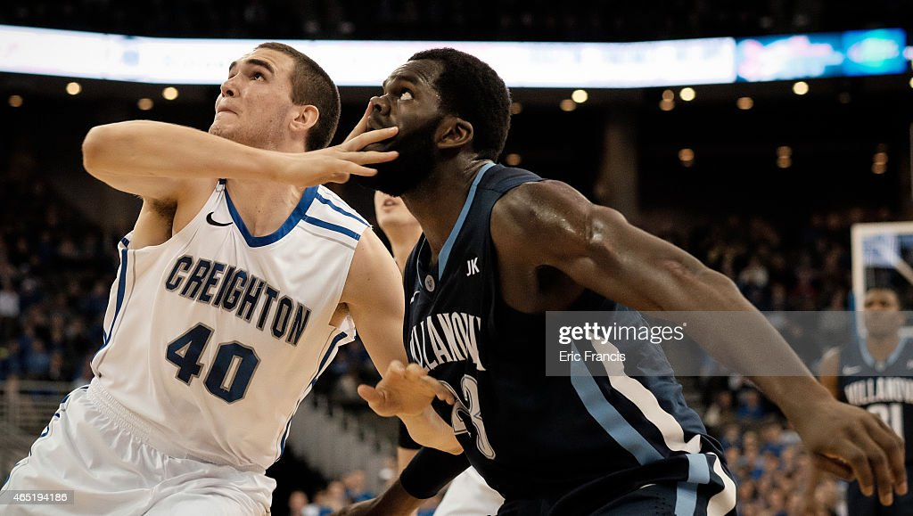 Zach Hanson of the Creighton Bluejays fights for position with Daniel Ochefu of the Villanova Wildcats during their game at CenturyLink Center March...