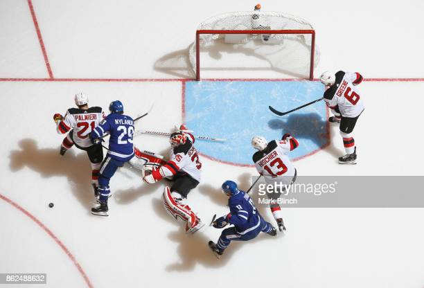 Zach Hyman and William Nylander of the Toronto Maple Leafs go to the net against Cory Schneider Andy Greene Nico Hischier and Kyle Palmieri of the...