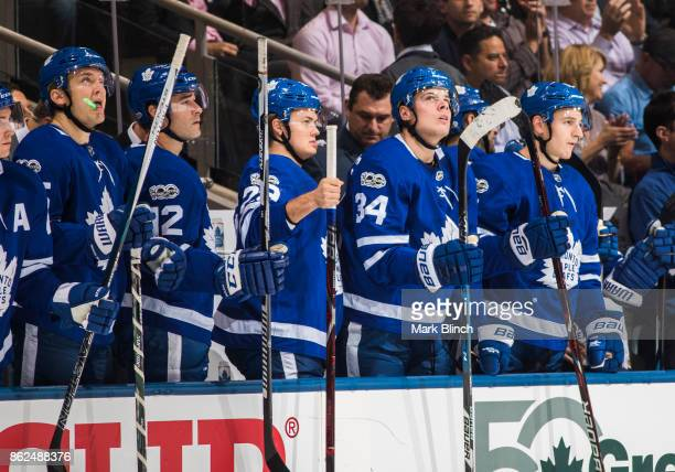 Zach Hyman Auston Matthews William Nylander Patrick Marleau and James van Riemsdyk of the Toronto Maple Leafs cheer from the bench while playing the...