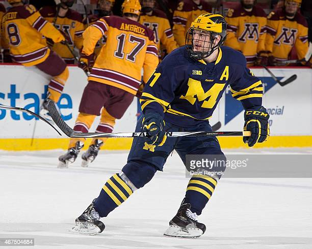 Zach Hyman of the Michigan Wolverines follows the play against the Minnesota Golden Gophers during the finals of Big Ten Mens Ice Hockey Championship...