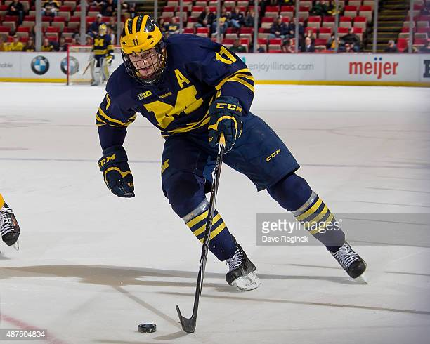 Zach Hyman of the Michigan Wolverines skates up ice with the puck against the Minnesota Golden Gophers during the finals of Big Ten Mens Ice Hockey...