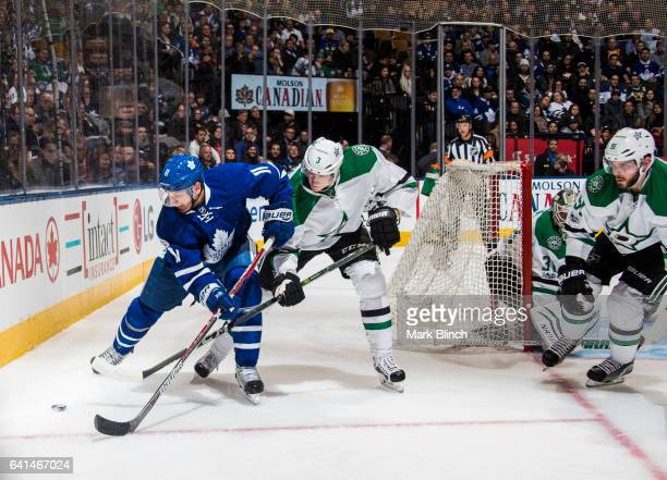 Zach Hyman of the Toronto Maple Leafs battles for the puck with John Klingberg and Tyler Seguin of the Dallas Stars during the first period at the...