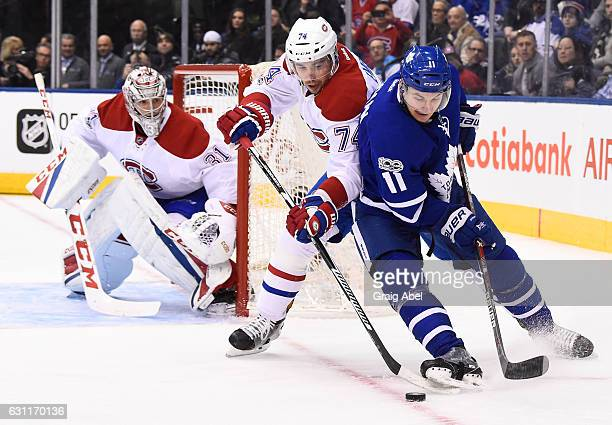 Zach Hyman of the Toronto Maple Leafs battles with Alexei Emelin of the Montreal Canadiens during the first period at the Air Canada Centre on...