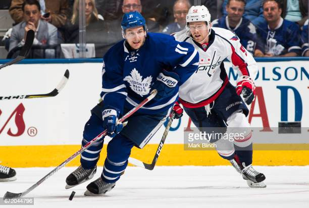 Zach Hyman of the Toronto Maple Leafs carries the puck past Evgeny Kuznetsov of the Washington Capitals during the first period in Game Six of the...