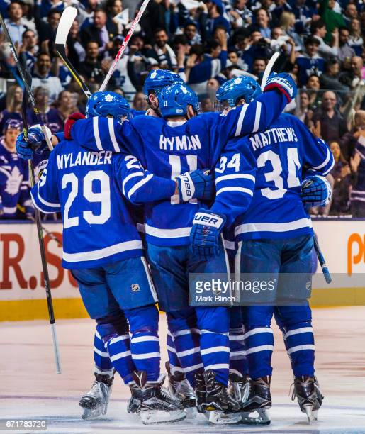 Zach Hyman of the Toronto Maple Leafs celebrates his goal with teammates William Nylander and Auston Matthews against the Washington Capitals during...