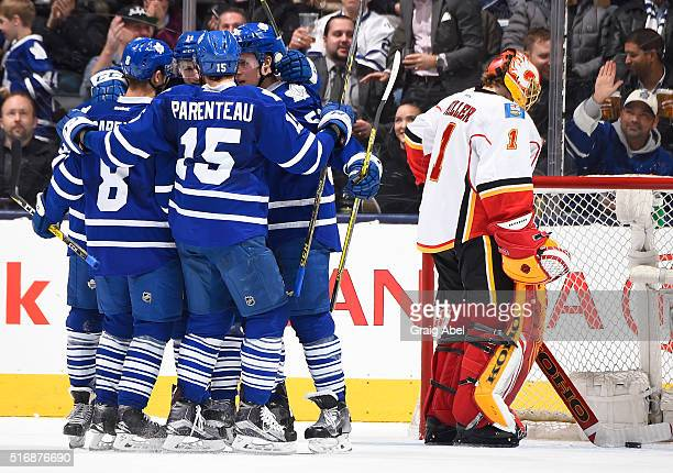 Zach Hyman of the Toronto Maple Leafs celebrates his goal with his teammates during game action against the Calgary Flames on March 21 2016 at Air...
