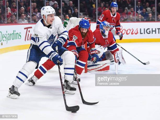 Zach Hyman of the Toronto Maple Leafs looks to pass the puck against Jordie Benn of the Montreal Canadiens in the NHL game at the Bell Centre on...