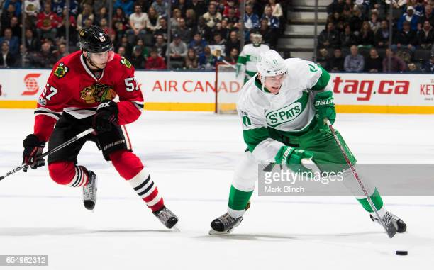 Zach Hyman of the Toronto Maple Leafs skates against Trevor van Riemsdyk of the Chicago Blackhawks during the first period at the Air Canada Centre...