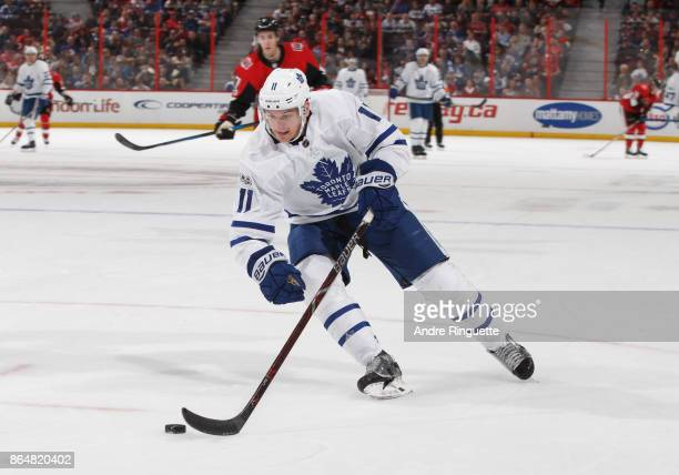 Zach Hyman of the Toronto Maple Leafs stickhandles the puck against the Ottawa Senators at Canadian Tire Centre on October 21 2017 in Ottawa Ontario...