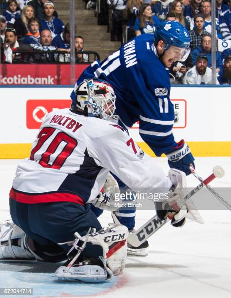 Zach Hyman of the Toronto Maple Leafs waits for a rebound in front of Braden Holtby of the Washington Capitals during the first period in Game Six of...