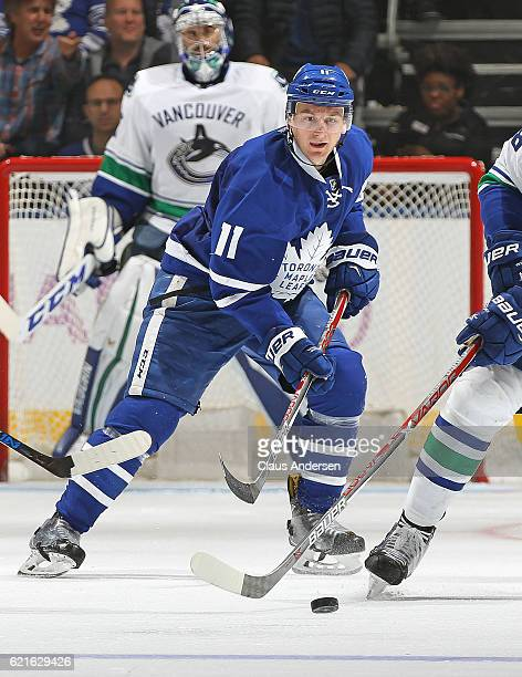 Zach Hyman of the Toronto Maple Leafs watches a loose puck against the Vancouver Canucks during an NHL game at the Air Canada Centre on November 5...