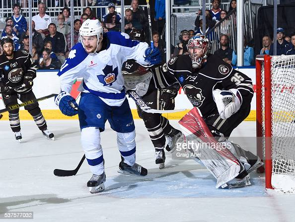 Zach Hyman of the Toronto Marlies battles for crease space with Justin Peters of the Hershey Bears during AHL Eastern Conference Final playoff game...