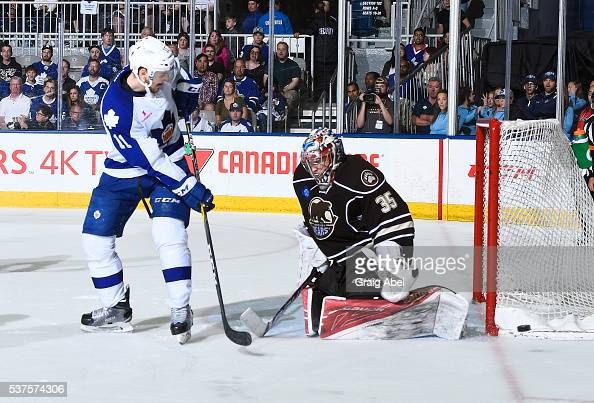 Zach Hyman of the Toronto Marlies slides the puck wide of Justin Peters of the Hershey Bears during AHL Eastern Conference Final playoff game action...