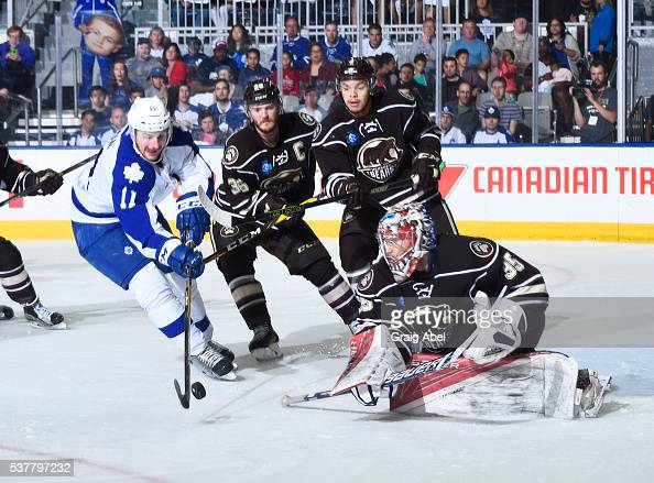 Zach Hyman of the Toronto Marlies tries to put the puck by Garrett Mitchell Madison Bowey and Justin Peters of the Hershey Bears during AHL Eastern...