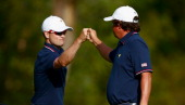 Zach Johnson and Jason Dufner of the US Team celebrate a birdie on the ninth hole during the Day One FourBall Matches at the Muirfield Village Golf...