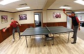 Zach Johnson and Phil Mickelson play a game of table tennis in the team cabin before practice for The Presidents Cup on September 26 at The Royal...