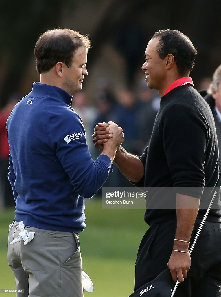 Zach Johnson (L) and Tiger Woods shake hands after Johnson defeated Woods on the first playoff hole during the final round of the Northwestern Mutual World Challenge at Sherwood Country Club on December 8, 2013 in Thousand Oaks, California.
