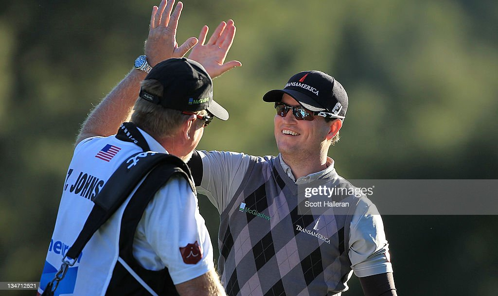Zach Johnson celebrates with his caddie Damon Green after holing out for eagle on the 18th hole during the third round of the Chevron World Challenge at Sherwood Country Club on December 3, 2011 in Thousand Oaks, California.