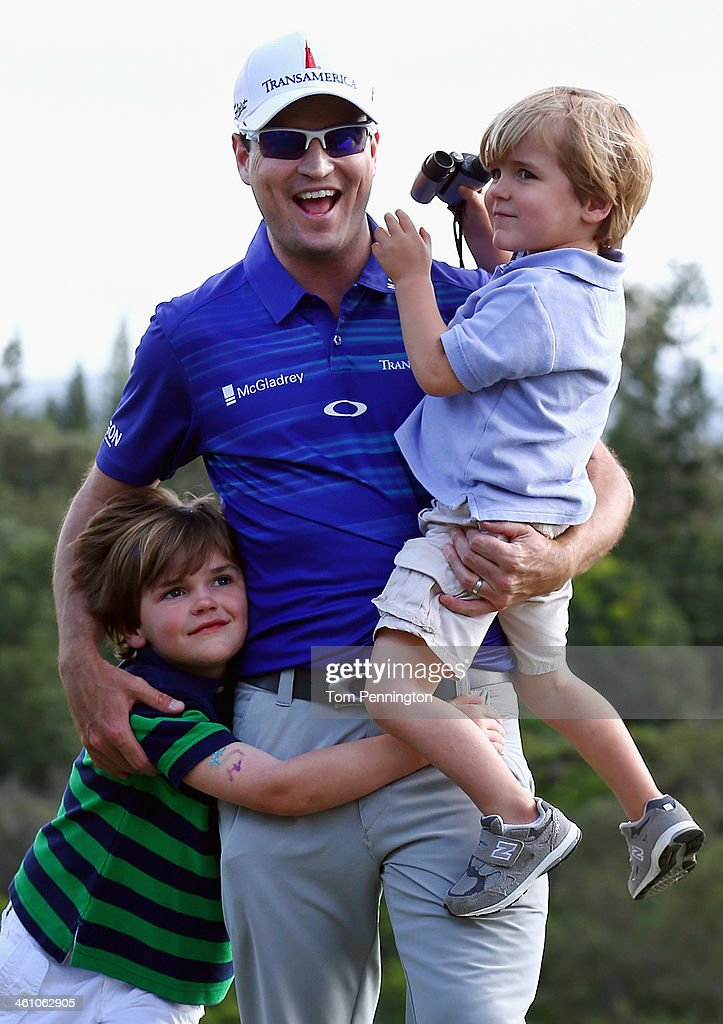 Zach Johnson celebrates with his sons Will and Wyatt after winning the Hyundai Tournament of Champions at the Plantation Course at Kapalua Golf Club...
