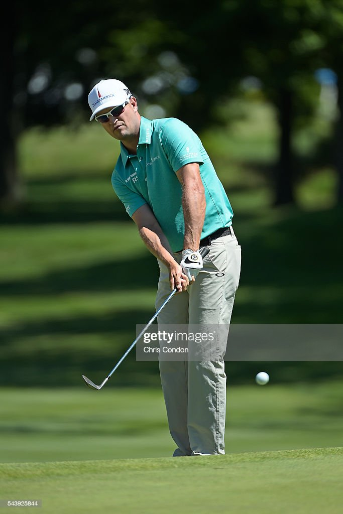 Zach Johnson chips to the first green during the first round of the World Golf Championships-Bridgestone Invitational at Firestone Country Club on June 30, 2016 in Akron, Ohio.