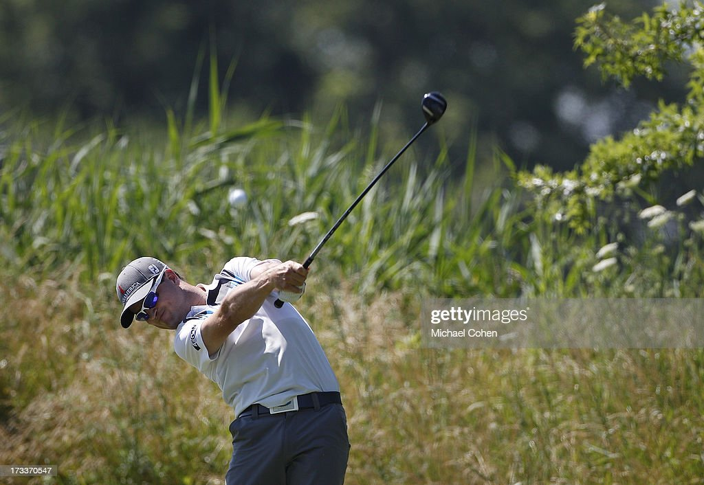 Zach Johnson hits a drive during the second round of the John Deere Classic held at TPC Deere Run on July 12, 2013 in Silvis, Illinois.