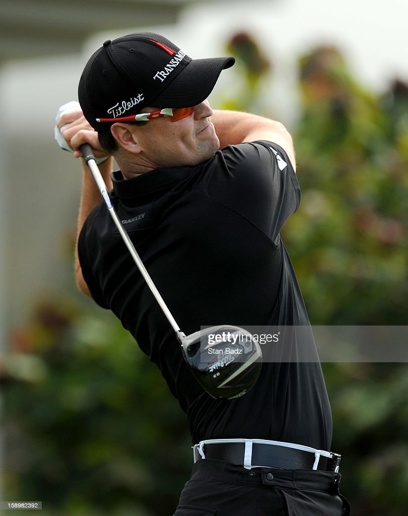 Zach Johnson hits a drive on the first hole during the first round of the Hyundai Tournament of Champions at Plantation Course at Kapalua on January 4, 2013 in Kapalua, Hawaii.