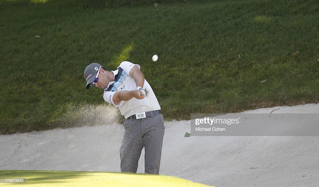 Zach Johnson hits a shot from a fairway bunker during the second round of the John Deere Classic held at TPC Deere Run on July 12, 2013 in Silvis, Illinois.