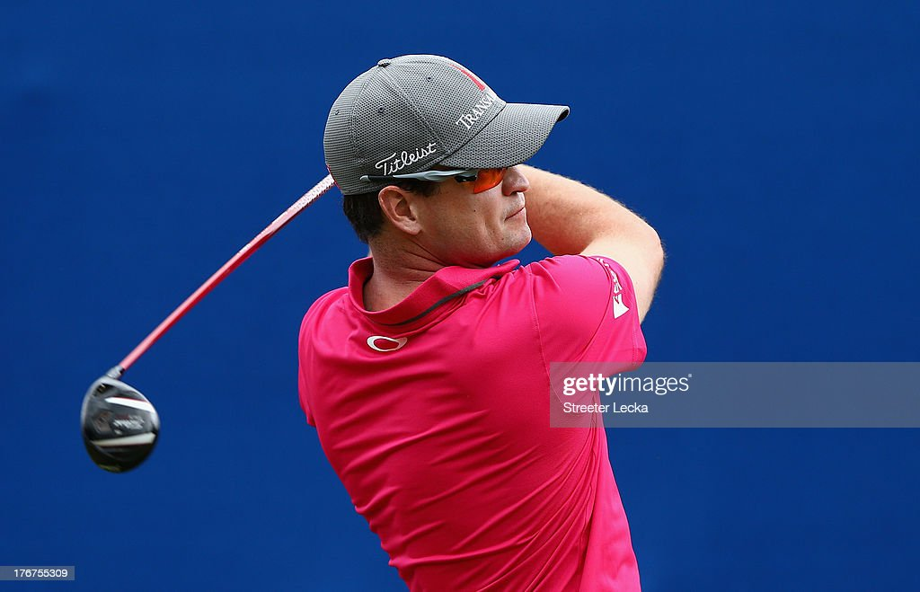 Zach Johnson hits a tee shot on the 10th hole during the final round of the Wyndham Championship at Sedgefield Country Club on August 18, 2013 in Greensboro, North Carolina.