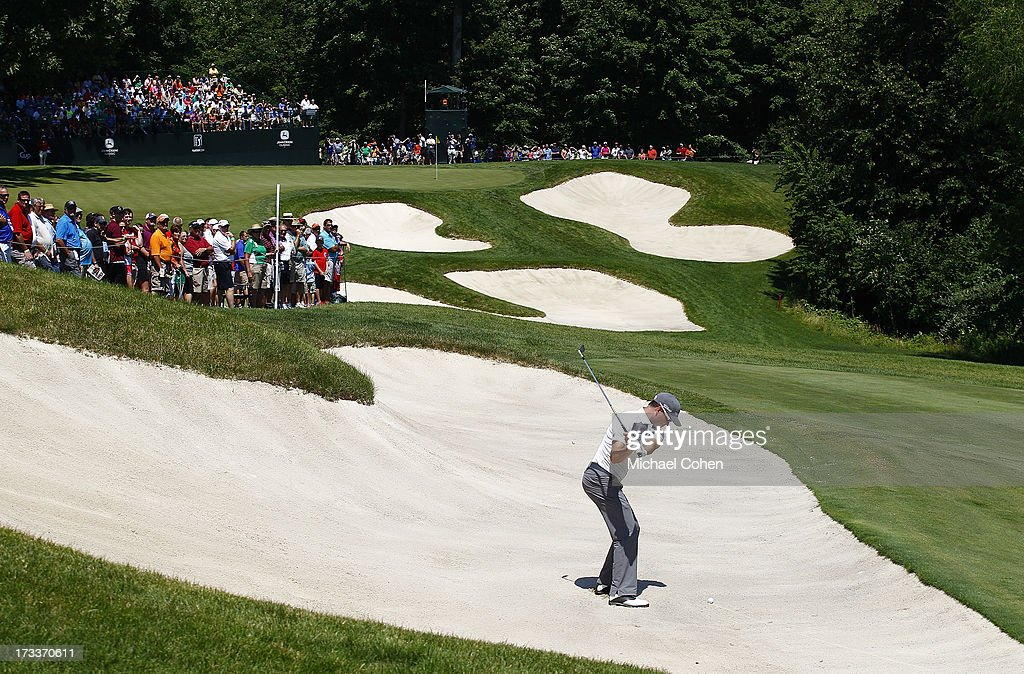 Zach Johnson hits his second shot on the fifth hole from a fairway bunker during the second round of the John Deere Classic held at TPC Deere Run on July 12, 2013 in Silvis, Illinois.