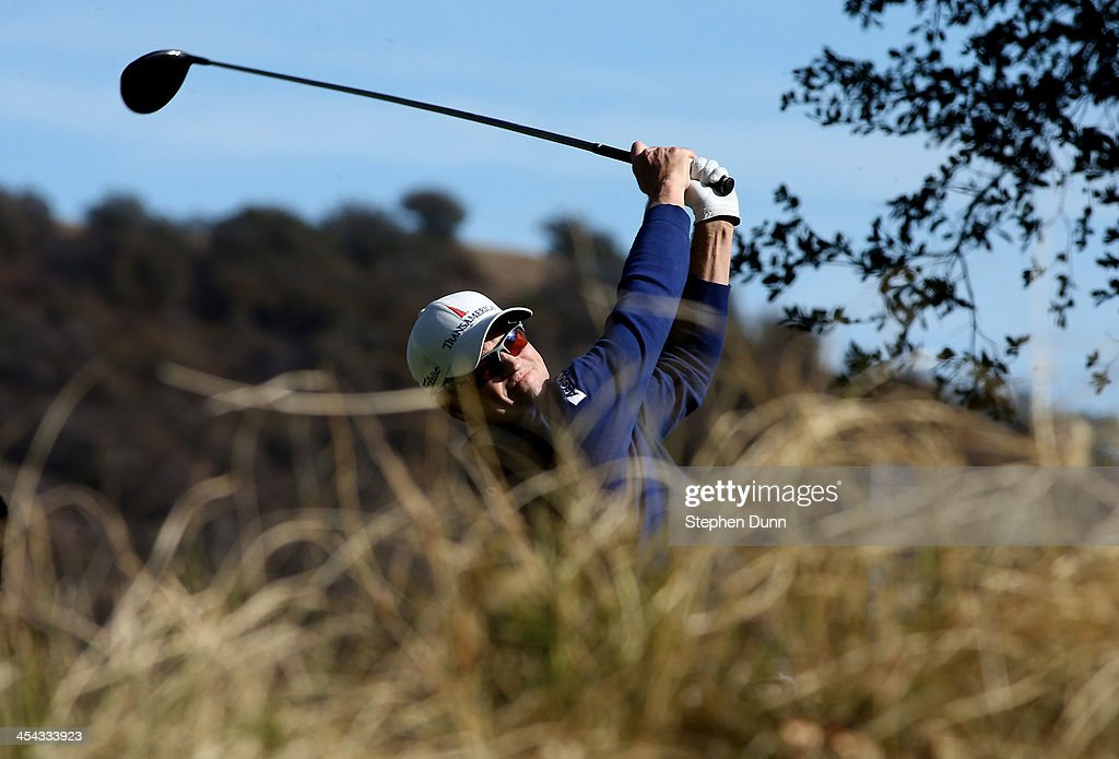 Zach Johnson hits his tee shot on the 11th hole during the final round of the Northwestern Mutual World Challenge at Sherwood Country Club on December 8, 2013 in Thousand Oaks, California.