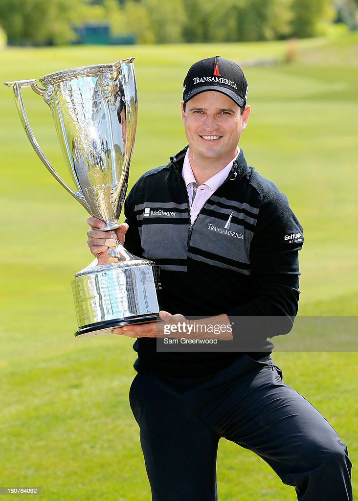 Zach Johnson holds the championship trophy after winning the BMW Championship at Conway Farms Golf Club on September 16 2013 in Lake Forest Illinois...