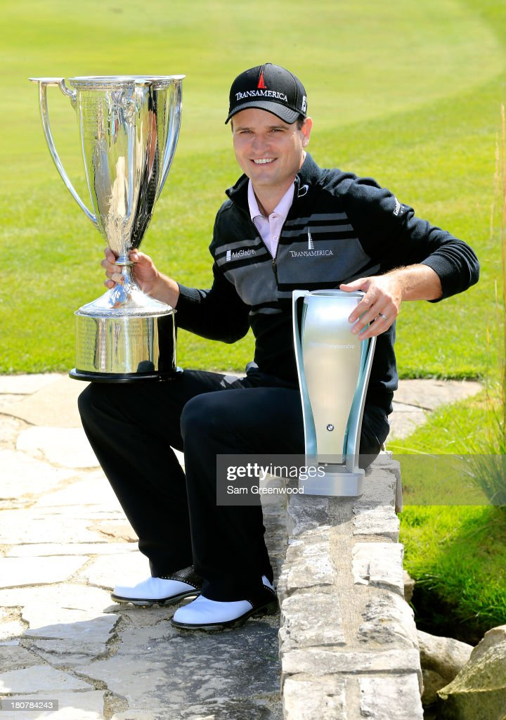 Zach Johnson holds the JK Wadley Trophy and the after winning the BMW Championship at Conway Farms Golf Club on September 16 2013 in Lake Forest...