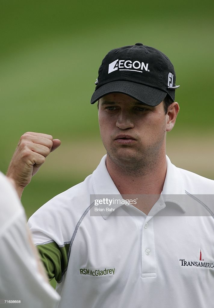 Zach Johnson knocks fists with his caddie after finishing up the third round in first place during The International at Castle Pines Golf Club on...