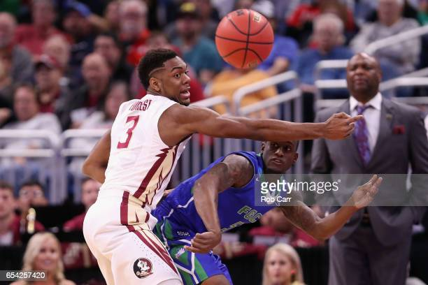 Zach Johnson of the Florida Gulf Coast Eagles passes the ball against Trent Forrest of the Florida State Seminoles in the first half during the first...