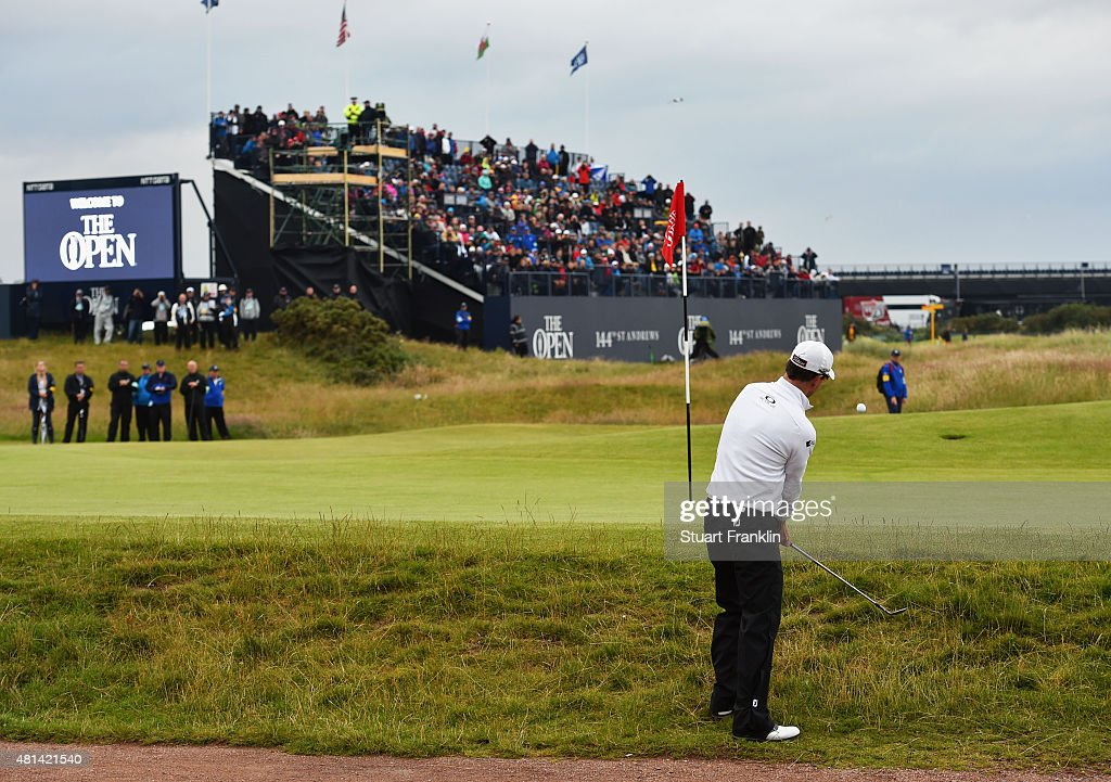 Zach Johnson of the United States chips onto the 17th hole in the playoff during the final round of the 144th Open Championship at The Old Course on...