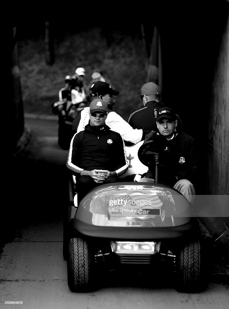 Zach Johnson of the United States drives in a golf cart during a practice round ahead of the 2014 Ryder Cup on the PGA Centenary course at the...
