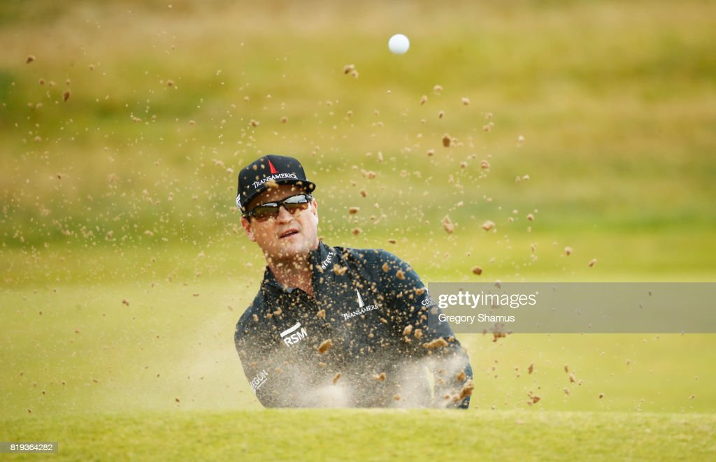 Zach Johnson of the United States hits a bunker shot on the 4th hole during the first round of the 146th Open Championship at Royal Birkdale on July 20, 2017 in Southport, England.