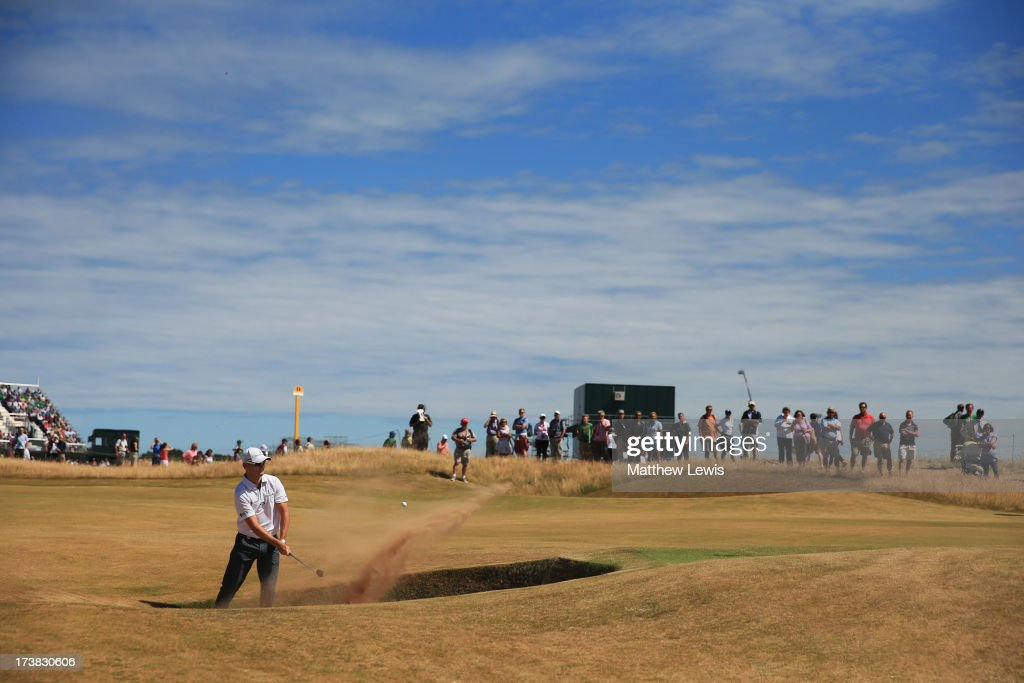 Zach Johnson of the United States hits out of a bunker on the 14th hole during the first round of the 142nd Open Championship at Muirfield on July 18, 2013 in Gullane, Scotland.