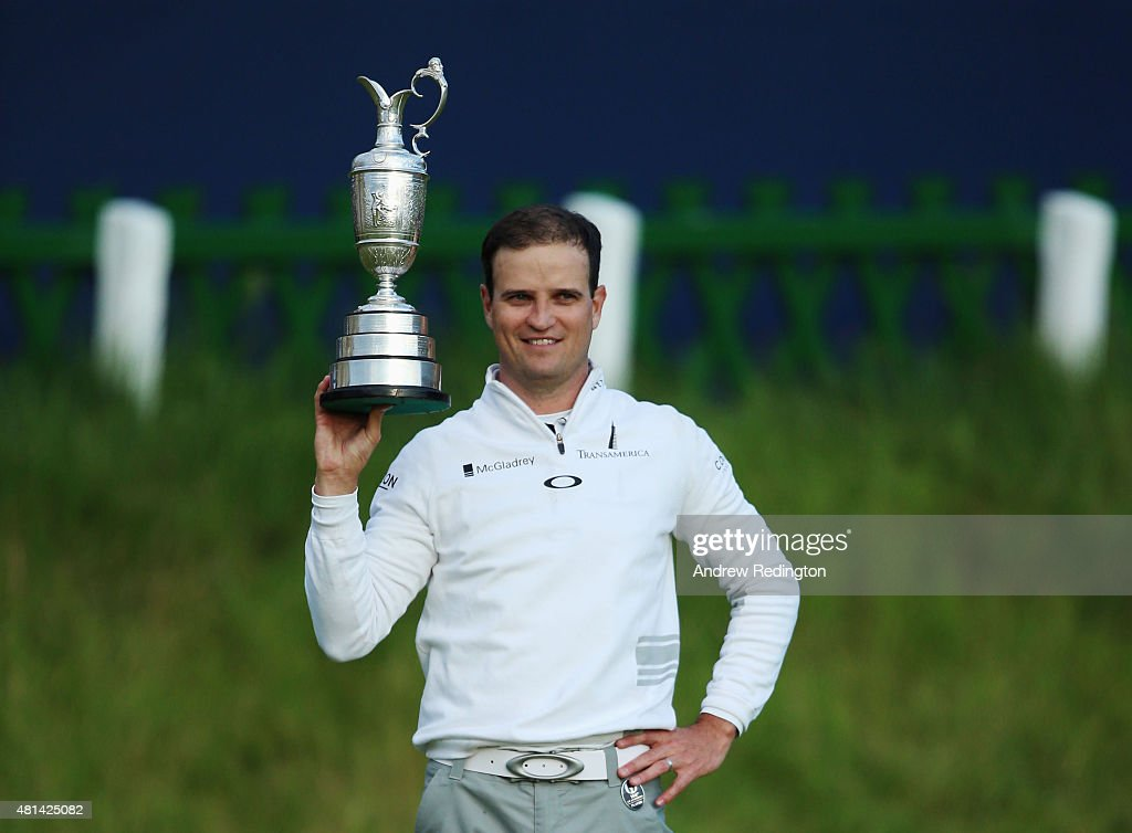 Zach Johnson of the United States holds the Claret Jug after winning the 144th Open Championship at The Old Course during a 4hole playoff on July 20...