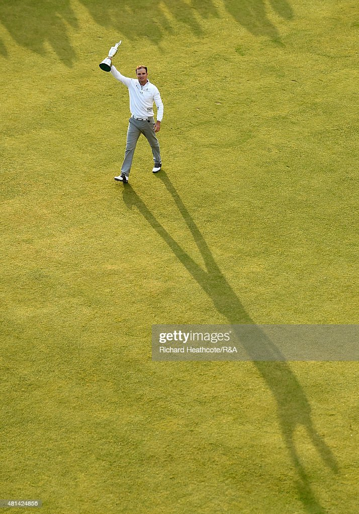 Zach Johnson of the United States holds the Claret Jug aloft after winning during the play off of the 144th Open Championship at The Old Course on...