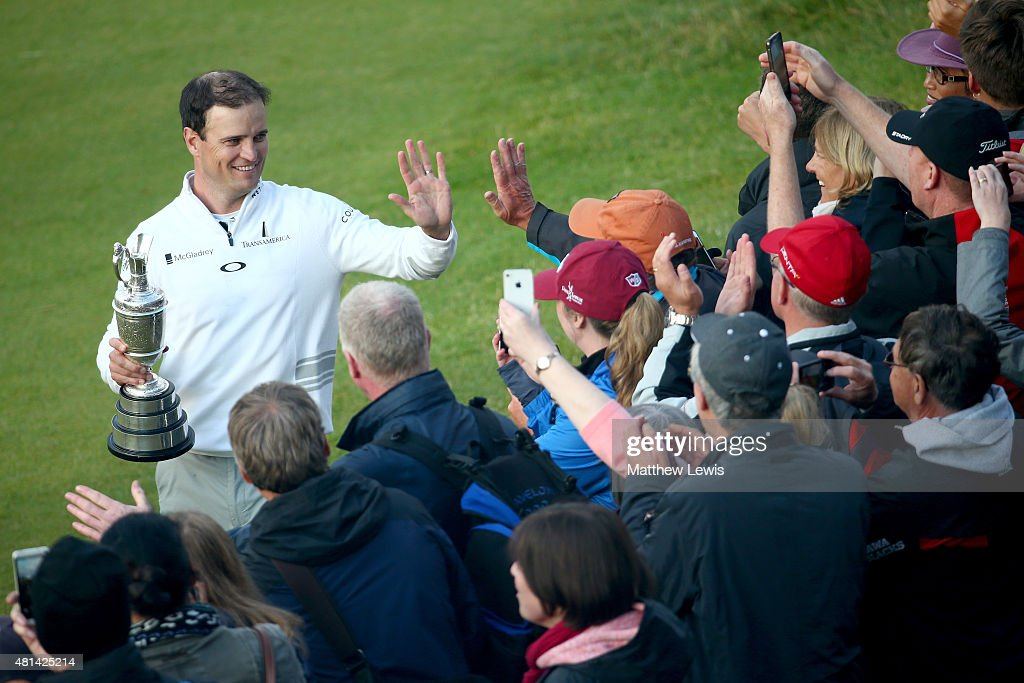 Zach Johnson of the United States holds the Claret Jug and celebrates with fans after winning the 144th Open Championship at The Old Course during a...