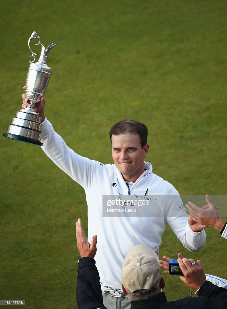 Zach Johnson of the United States holds the Claret Jug as he celebrates with spectators after winning the 144th Open Championship at The Old Course...