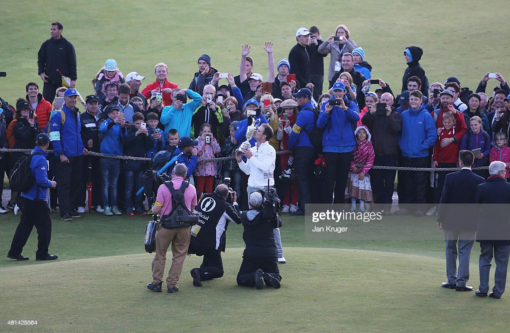 Zach Johnson of the United States kisses the Claret Jug as he poses for photographers after winning the 144th Open Championship at The Old Course...