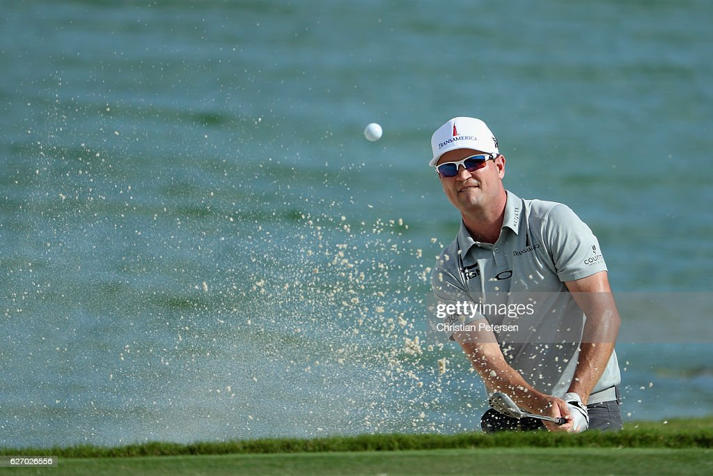 Zach Johnson of the United States plays a shot from a greenside bunker on the ninth hole during round one of the Hero World Challenge at Albany, The Bahamas on December 1, 2016 in Nassau, Bahamas.