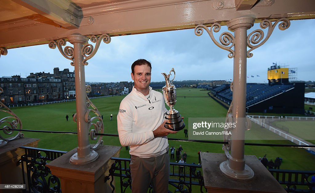 Zach Johnson of the United States poses with the Claret Jug on the RA clubhouse balcony after winning during the play off of the 144th Open...
