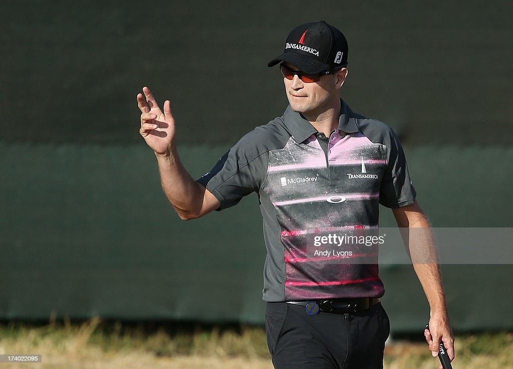 Zach Johnson of the United States reacts after a birdie putt on the 13th hole during the second round of the 142nd Open Championship at Muirfield on July 19, 2013 in Gullane, Scotland.