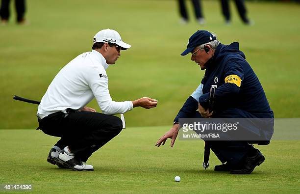 Zach Johnson of the United States talks with a rules official on the 18th hole during the play off of the 144th Open Championship at The Old Course...